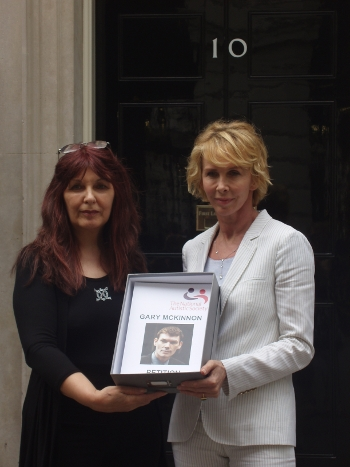 Janis Sharp and Trudie Styler present petition to Sarah Brown at No10